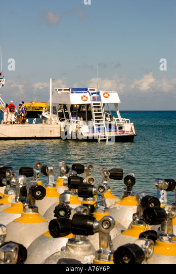 Cozumel Mexico San Miguel town Scuba sport diving steel compressed air tanks dive boat - Stock Image