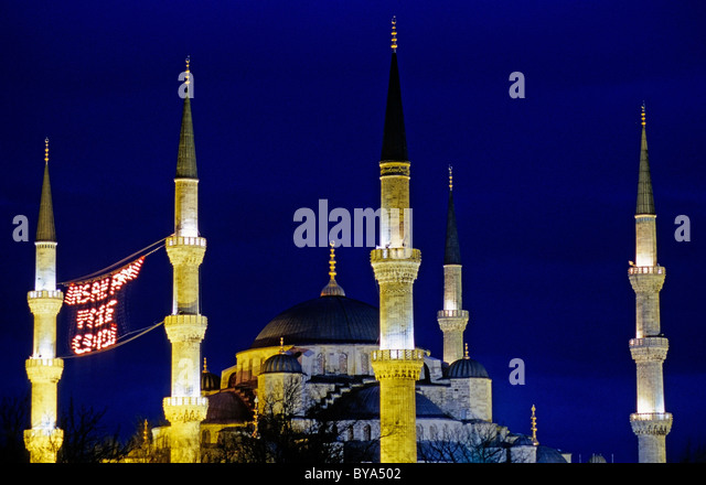 Illuminated towers of the Blue Mosque at night, Istanbul, Turkey. - Stock Image