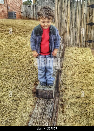 Little boy big step HDR - Stock Image