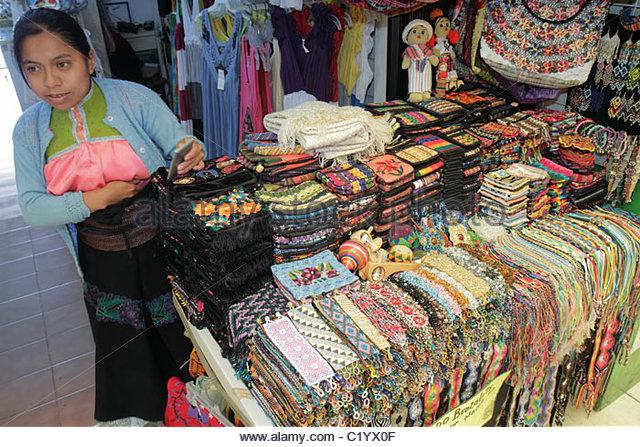 Cancun Mexico Yucatán Peninsula Quintana Roo Beach Hotel Zone Avenida Kukulkan Hispanic woman sales clerk gift - Stock Image