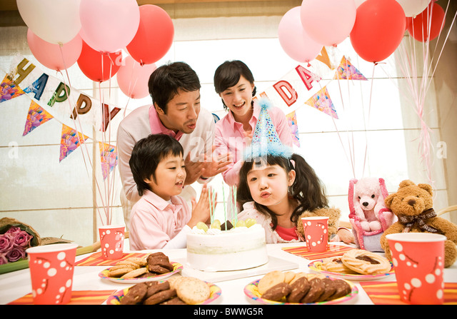 Family having birhtday party - Stock Image