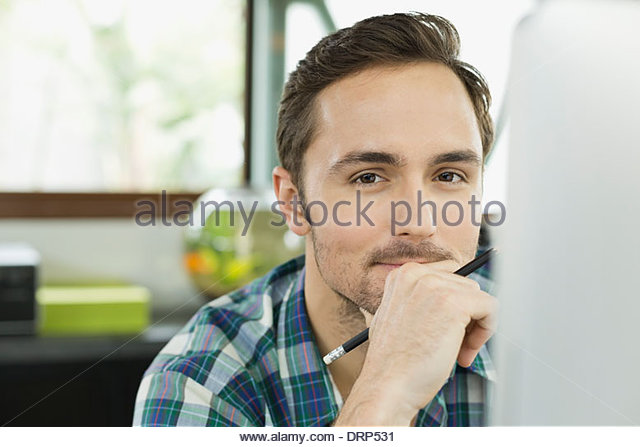 Portrait of young working professional in home office - Stock Image