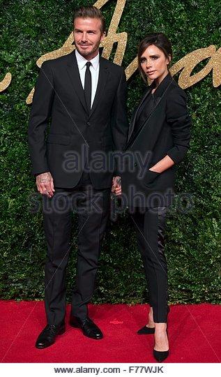 epa05039029 British soccer star David Beckham (L) and his wife British fashion designer Victoria Beckham (R) arrive - Stock Image