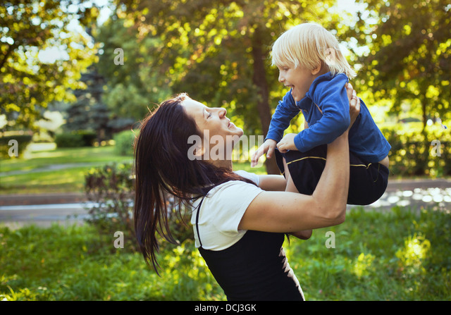 happy family, mother playing with son - Stock-Bilder
