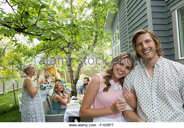 Portrait smiling couple at garden party lunch - Stock Image