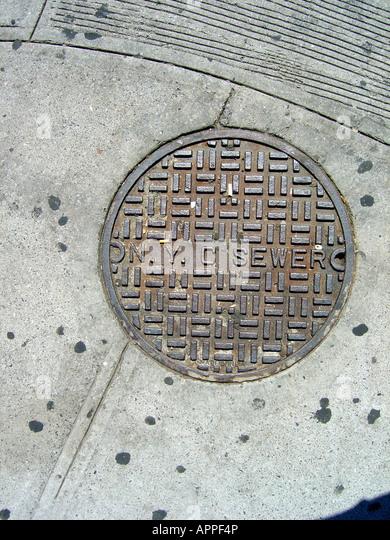 New York City Sewer Manhole Cover - Stock Image