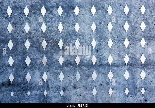 Geometric pattern wall made by rhombus on a wall - Stock Image