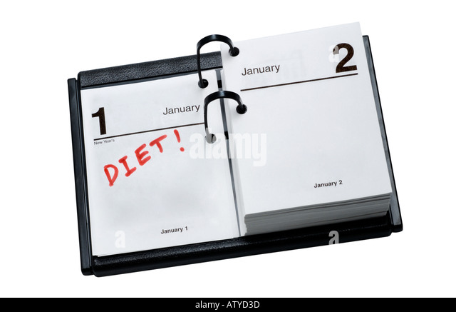 Desk Calendar with DIET written as a New Years Resolution - Stock Image