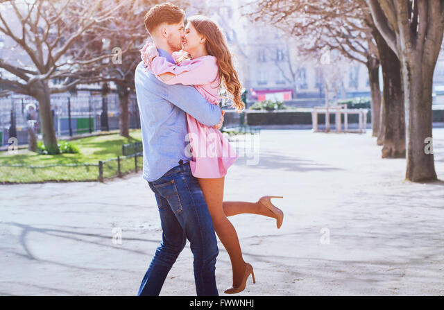 happy young beautiful couple kissing and smiling outdoors - Stock-Bilder