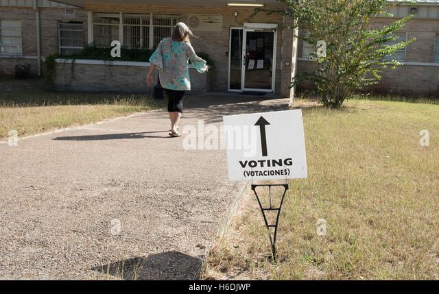 Woman walks towards polling station in the small farming community of Goliad, Texas, during early voting period. - Stock Image