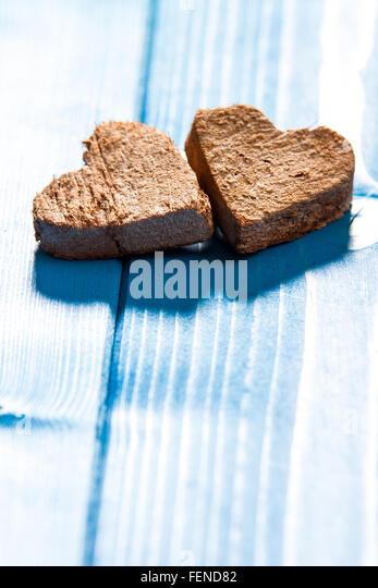 Wooden Hearts On Plank - Stock-Bilder