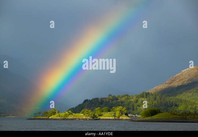 Loch Leven, near Glencoe, Lochaber, Highland, Scotland. Rainbow - Stock-Bilder