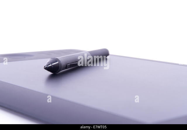 Digital pen on graphic tablet with depth of field, isolated on white background. - Stock Image