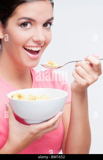 Portrait of a woman eating cereal - Stock-Bilder