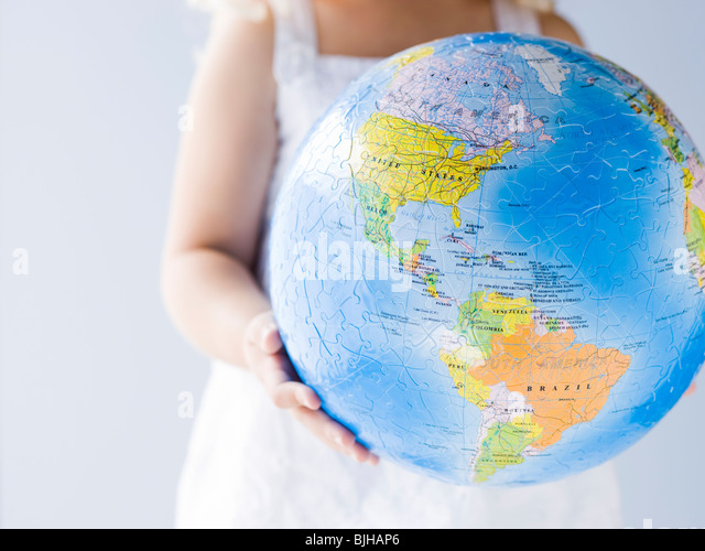 little girl holding a globe - Stock Image