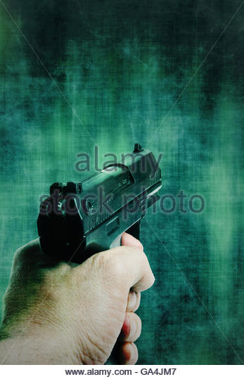 man hand holding a gun pointed - Stock Image