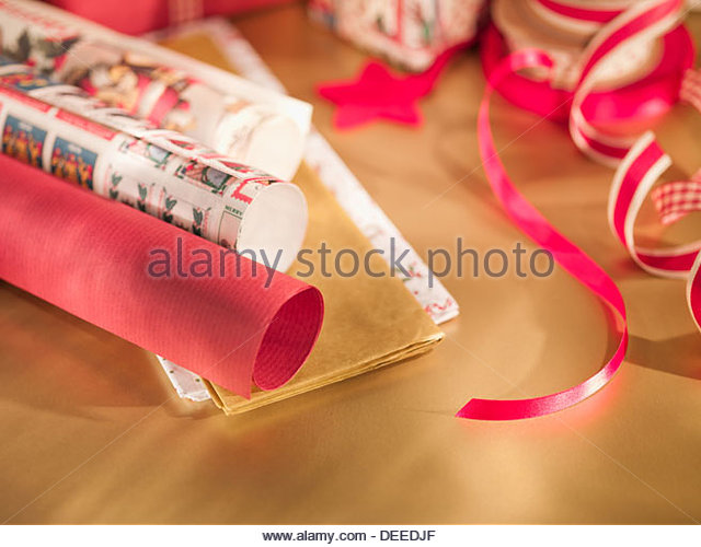 Christmas wrapping paper, ribbon - Stock Image