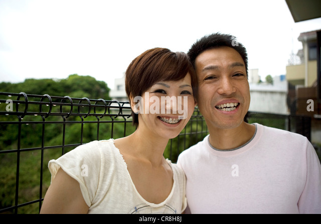 Portrait of a happy couple outdoors - Stock Image