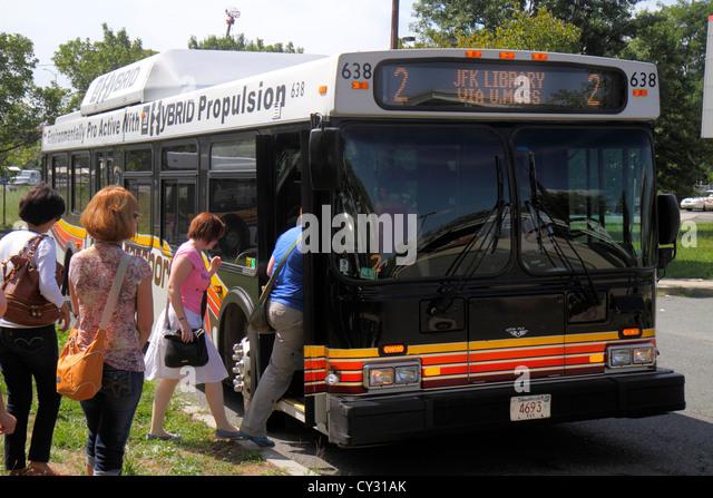 Boston Massachusetts South Boston JFK/UMass Station MBTA T Red Line subway bus transfer JFK Library passengers boarding - Stock Image