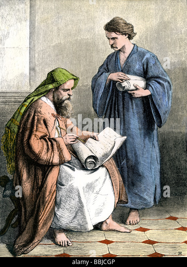Paul in a Roman prison writing the Epistles - Stock Image