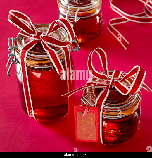 Ribbon tied jars cranberry jelly - Stock Image