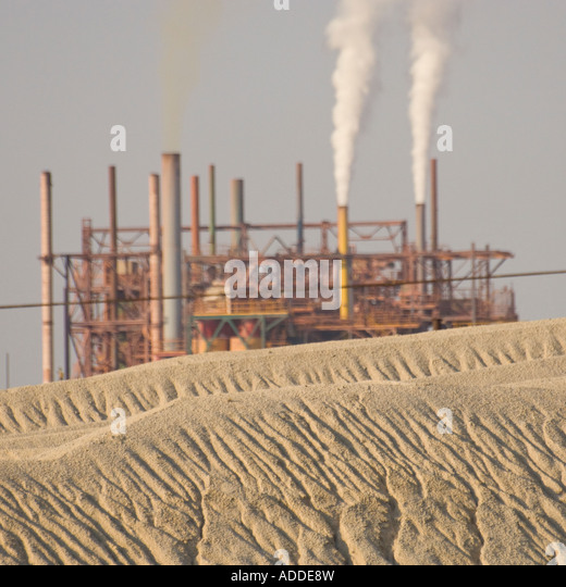 Israel Dead Sea area Industry Dead Sea Works Phosphates plant close up on sand tip with chimneys and plant in bkgd - Stock-Bilder