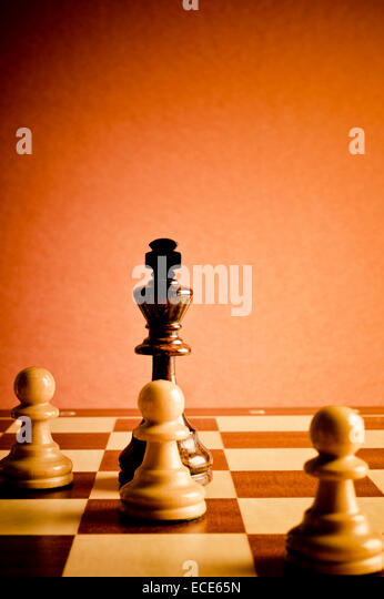 chess king and pawns, concept for teamwork and cooperation - Stock Image