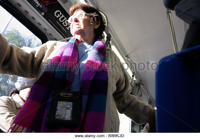 Miami Florida Miami-Dade Metrobus bus public transportation woman senior scarf passenger standing - Stock Image