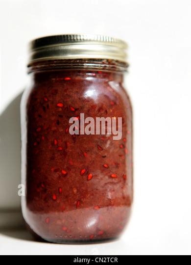 Jar of juneberry jam - Stock Image