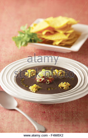 Black bean soup with corn and corn chips - Stock Image