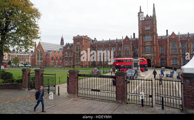 Queens University Belfast main building and modern Routemaster Bus,Northern Ireland,UK - Stock Image