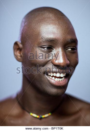 Close-up Portrait of African Man Smiling - Stock-Bilder
