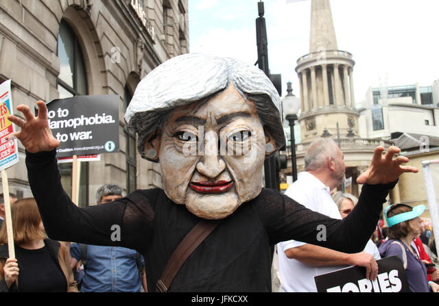 London, UK - 1 July 2017 - A demonstrator wearing an effigy of Teresa May takes part in the national demonstration - Stock Image
