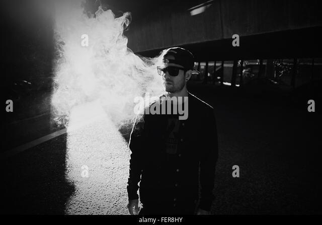 Man With Smoke In City - Stock-Bilder