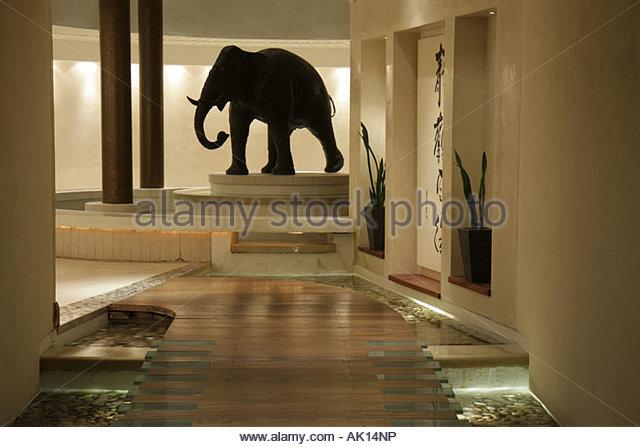 England UK Seaham Seaham Hall Hotel and Serenity Spa boardwalk path elephant statue Asian theme Feng Shui - Stock Image