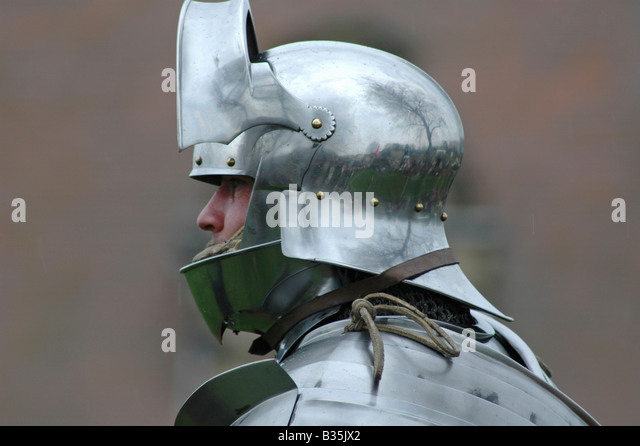 Close up knight's head in helmet - Stock Image