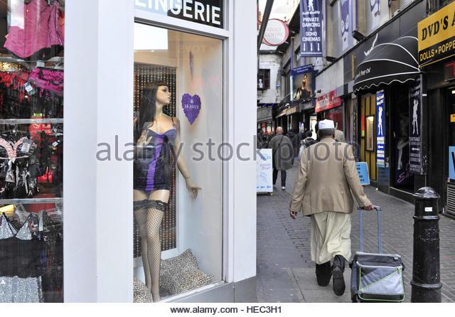 Muslim man walking through the street of Soho in central London UK - Stock-Bilder