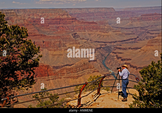 Arizona Grand Canyon National Park photographer with tripod at the canyon rim - Stock Image