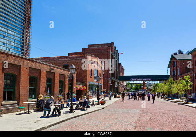 View down Trinity Street with The Brick Street Bakery cafe to the left, Distillery District, Toronto, Ontario, Canada - Stock Image