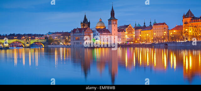 Prague Panorama. Panoramic image of Prague riverside and Charles Bridge, with reflection of the city in Vltava River. - Stock Image