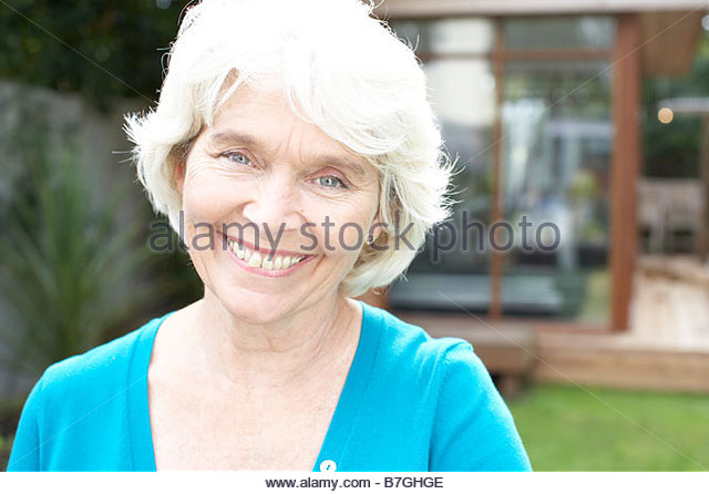 55-59 years, backyard, casual clothing, caucasian, close up, color image, confidence, day, front view, gray hair, - Stock Image