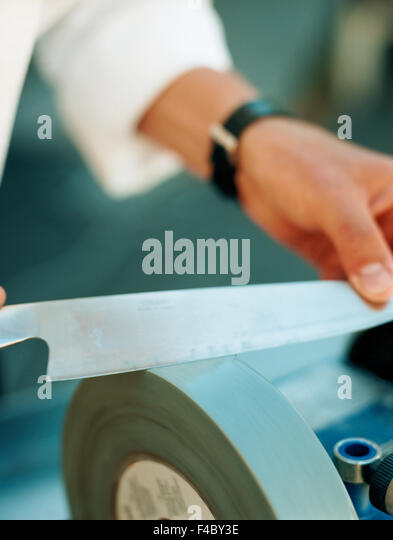 body part part of color image grindstone handicraft human hand knife part of quality sharpening - Stock-Bilder