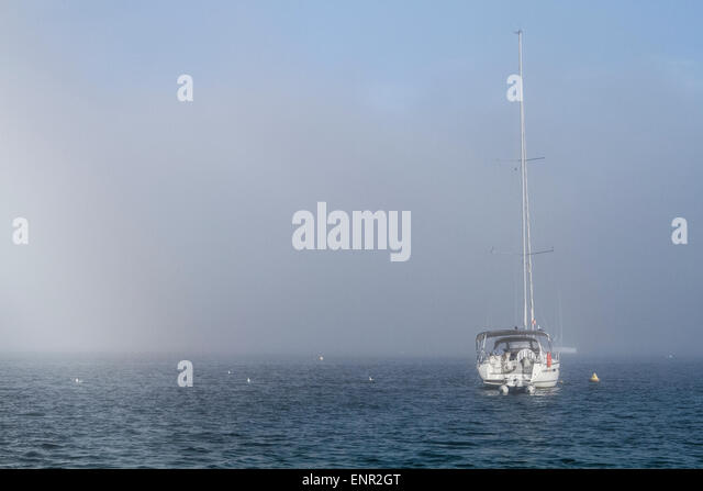 Boat in the fog at the bay of Cabrera Island, Travel to Majorka - Stock Image