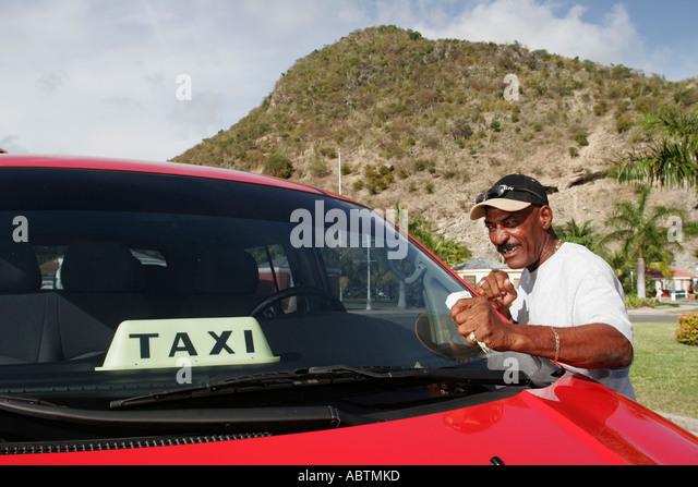 Sint Maarten Philipsburg Dutch Black male taxi cab driver Point Blanche Mountain - Stock Image
