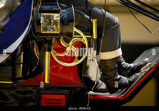 Close up of Carriage driver in traditional costume, boots, horse drawn carriage, Jerez de la Frontera, Andalucia, - Stock Image