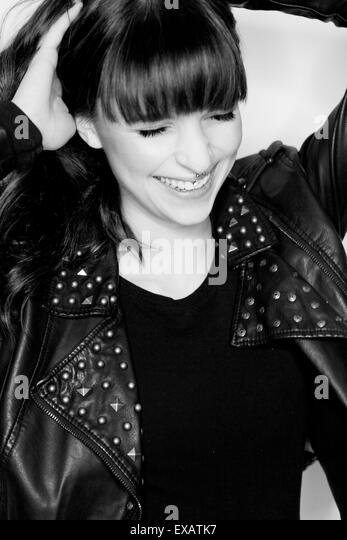 laughing young woman, b/w, portrait, - Stock Image