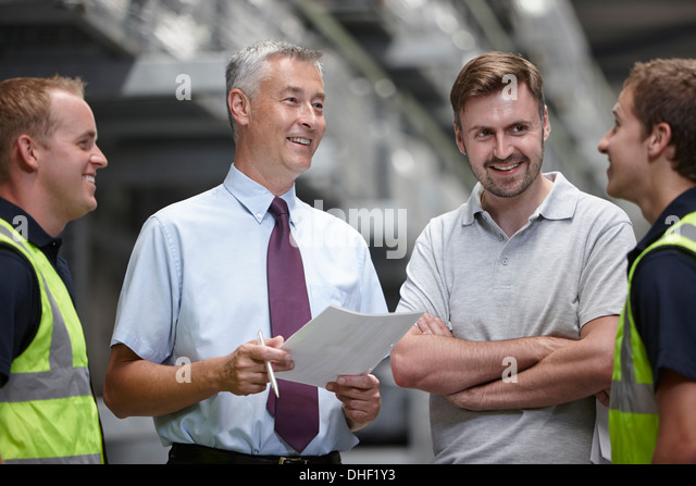 Warehouse workers and manager in engineering warehouse - Stock Image
