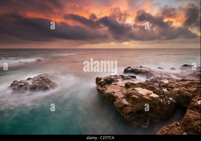 Beautiful seascape. Sea and rock at the sunset. Nature composition. - Stock Image