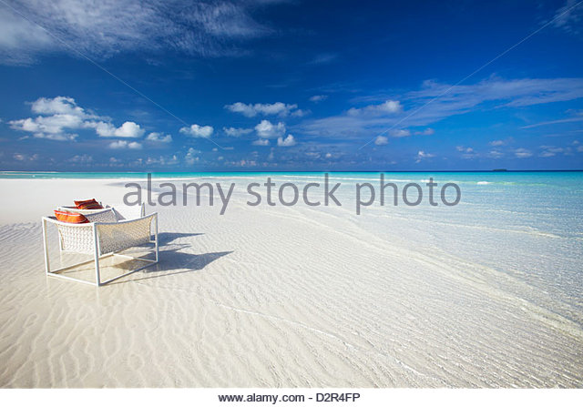 Deck chairs on tropical beach, Maldives, Indian Ocean, Asia - Stock Image