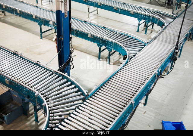 Rolling conveyor belt roller system for shipping in distribution warehouse - Stock Image